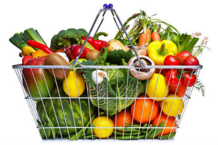 Fruit and vegetables in a metal basket.