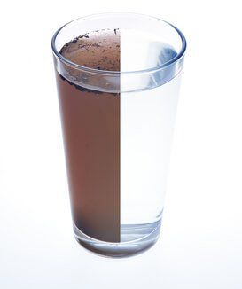 Contaminated Water - Glass of water half brown
