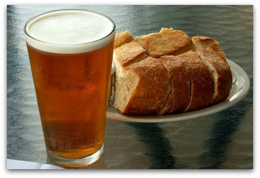 Gluten Intolerance Symptoms - Glass of Beer with a Plate of Bread
